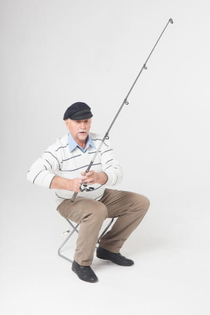 釣竿を持つ釣り師